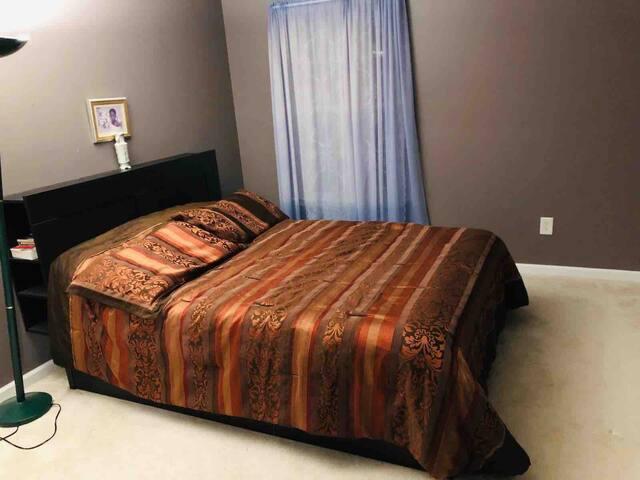 Bedroom, queen bed with closet.