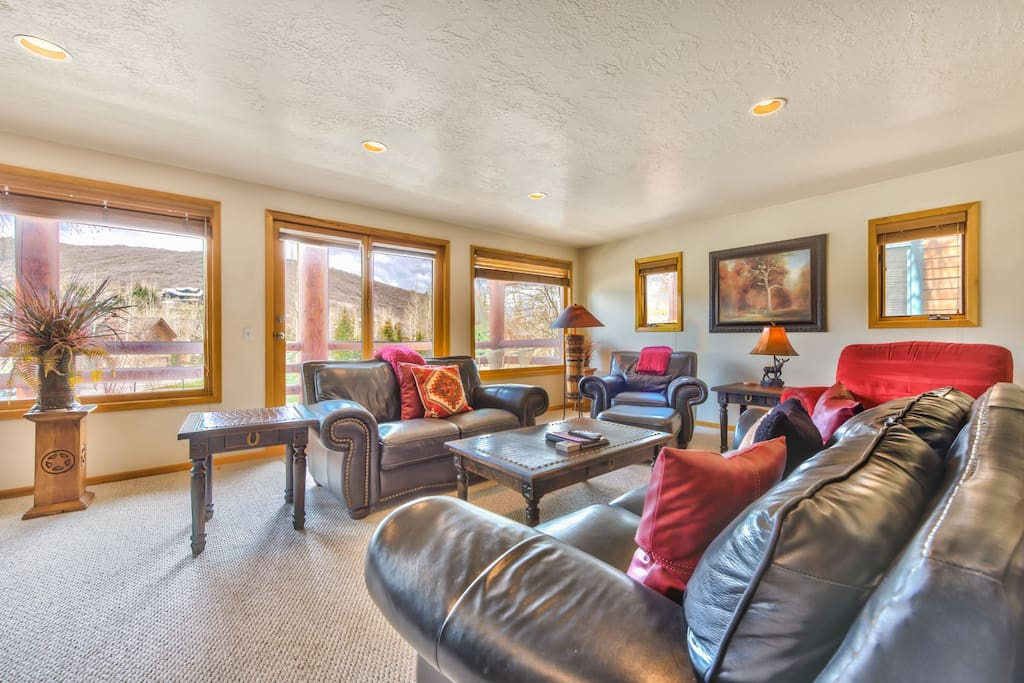 Spacious Living Room on Main Level with Flat Screen TV, DVD, Gas Fireplace, and Deck with a Beautiful Vew of Deer Valley