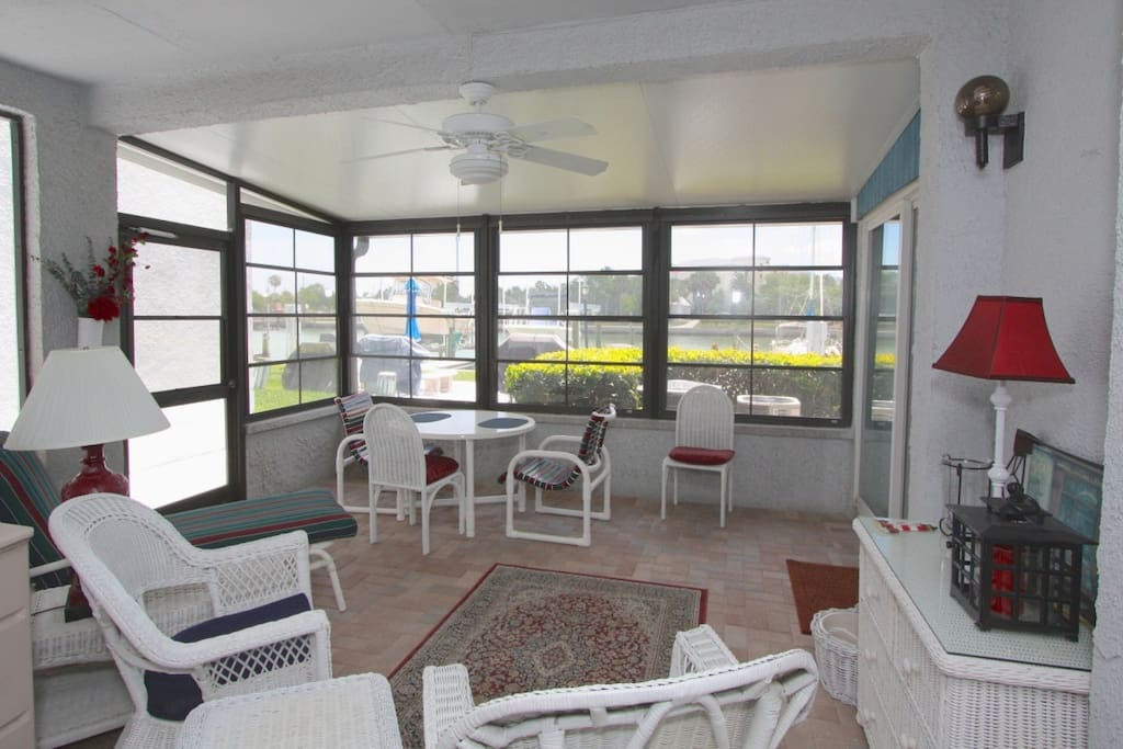 Porch seating with a view of the intercoastal.