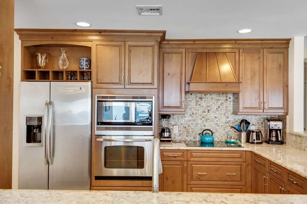 Panoramic views form the fully stocked gourmet kitchen