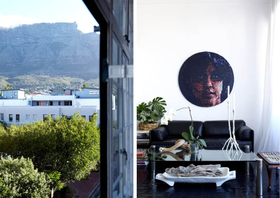 City loft apartment with Table Mountain view, open-plan living, dining and kitchen. Upstairs mezzanine bedroom.