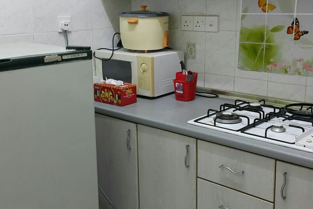 Kitchen with rice cooker, microwave, fridge