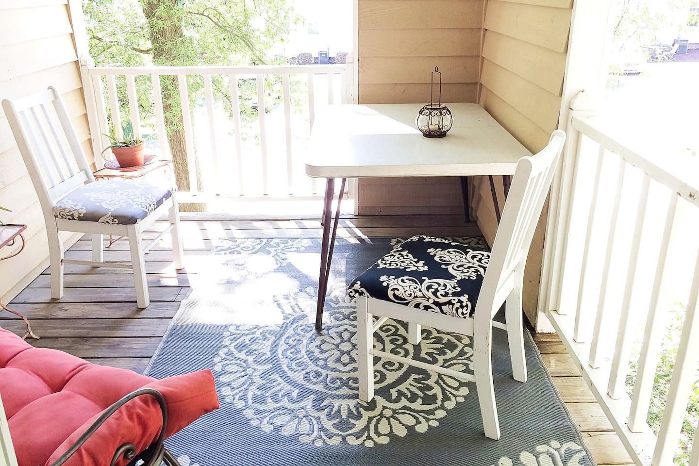 The back door between the DR and Kit leads to a great porch large enough to dine, lounge or work - my favorite place!