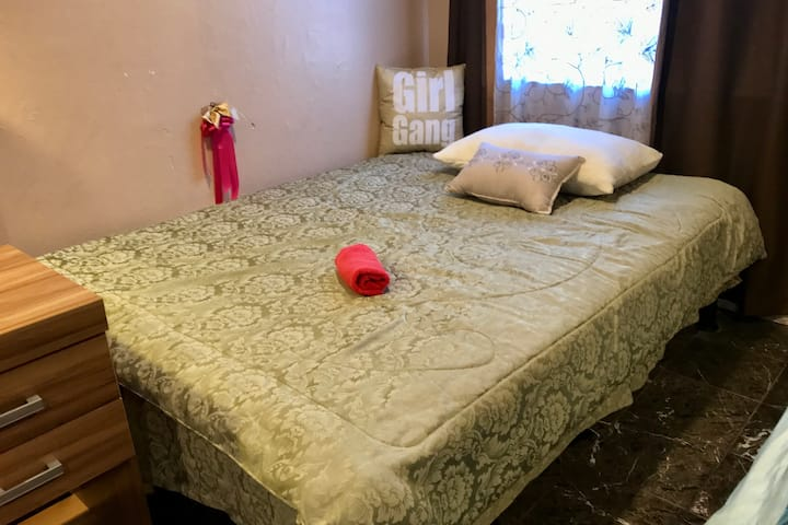 Females Place ~ Spacious Room ~ Queen Bed on Left