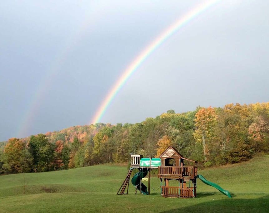 Backyard with playhouse and sandbox for the kids