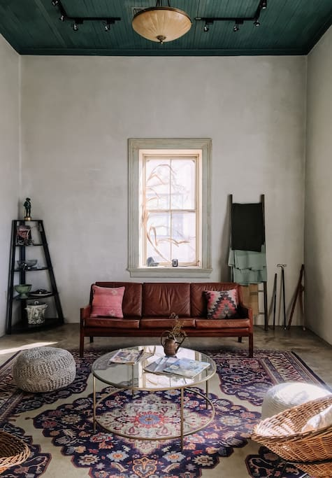 Our light-filled living room, thoughtfully designed with vintage and contemporary furnishings.   Photographed by Rebecca Murphy