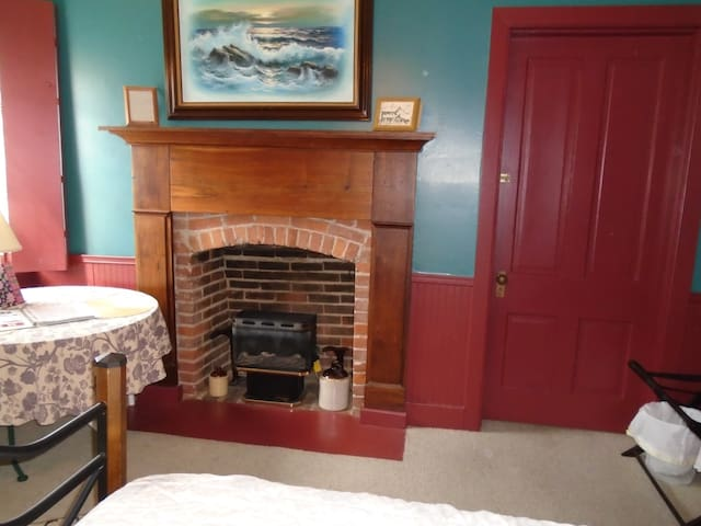 GAS FIREPLACE, IN SEASON, IS AN INSERT AS THIS IS AN ORIGINAL FIREPLACE.