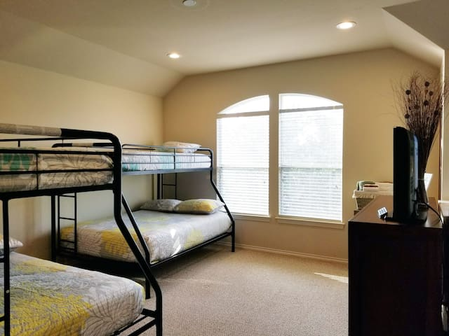 """3rd Floor Loft - Vaulted ceilings with 2 """"Twin over Full"""" bunk beds.  *Note:  there is no bathroom connection with the loft room - guests can use the primary bathroom located on the same floor."""