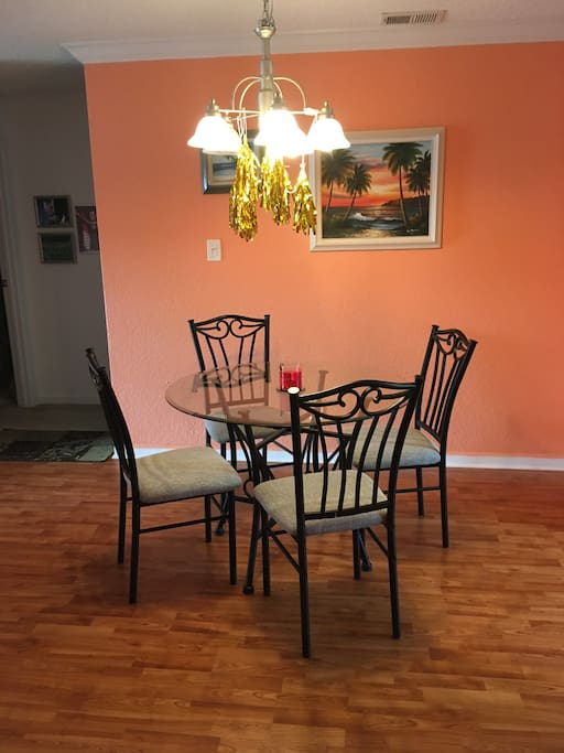 Combination living rm/dining rm area. Glass table/4 chairs.