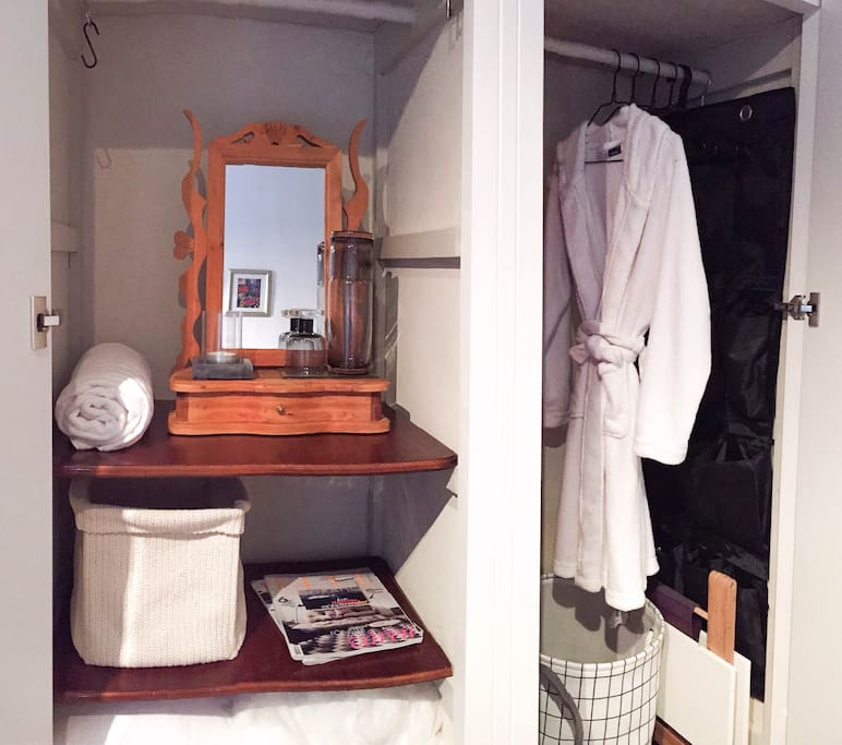 Private wardrobe space. Bathrobe, slippers.