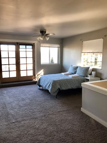 A Master bedroom w/ patio and private luxury bath