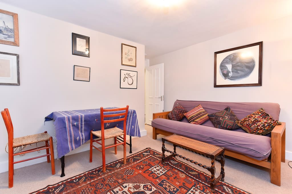The sitting room contains a double sofa bed, a dining table (seats 2) and a flat screen wall mounted TV. Wifi is available throughout the flat.