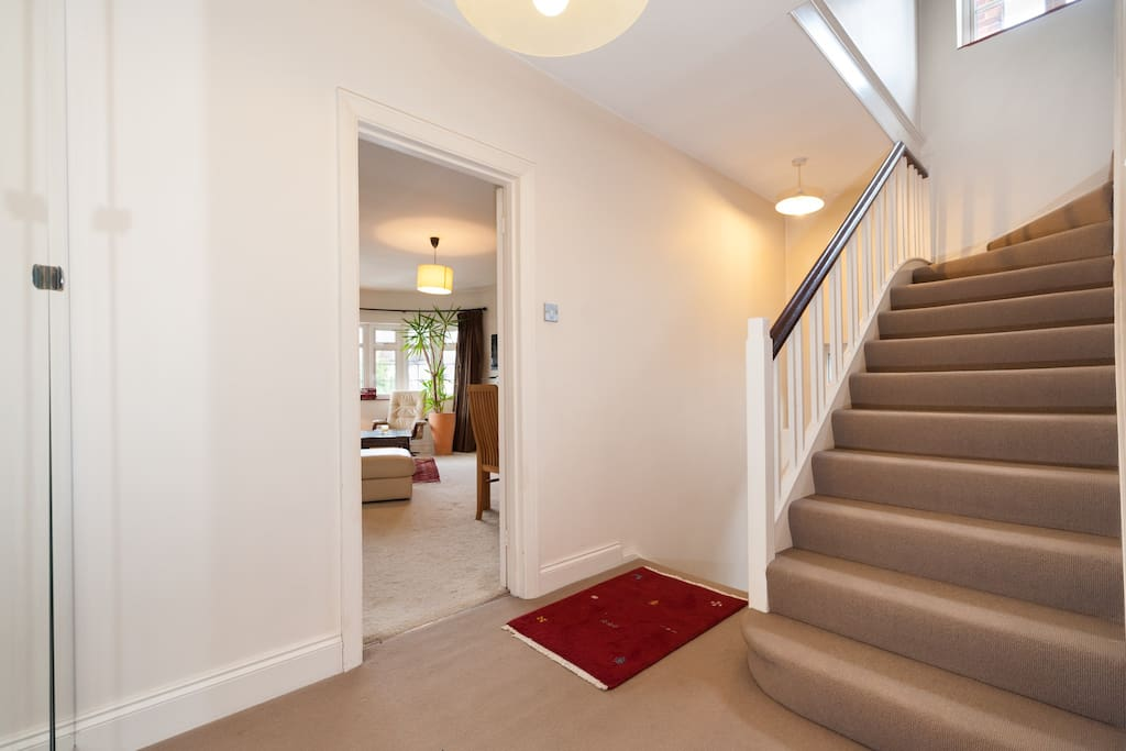 Split level staircase leading to upstairs bedroom and bathroom