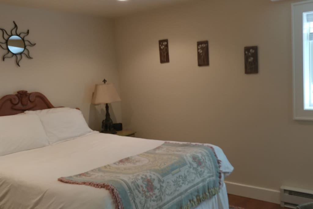 One of the bedrooms with a queen bed, internet TV, and lock on door.