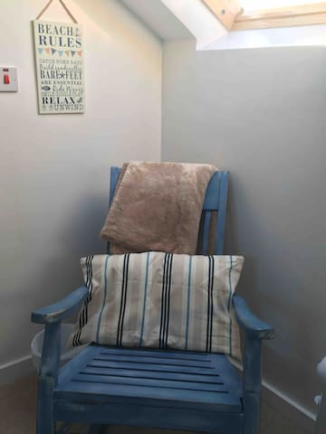 Rocking chair in the corner where you can snuggle up with a book and soak in the sun from the roof window! Relax :-)