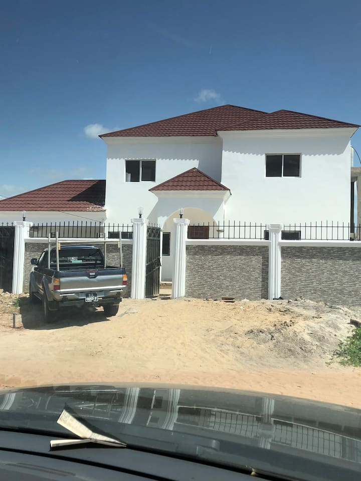 A fantastic five bedroom family home with a pool.  Rooms available for individuals or couples.  Two of the bedrooms have super king size beds.  Security guard, full air conditioning and airport pick up available.  A 4X4 and driver available if required.