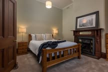 Downstairs Bedroom with a Queen Size AH Beard luxury mattress.