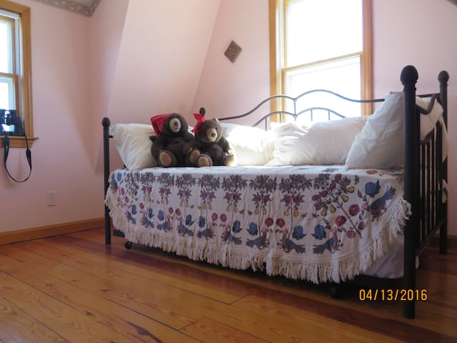 Upstairs second bedroom with a daybed and pull out trundle bed to sleep two.  View to the ocean.