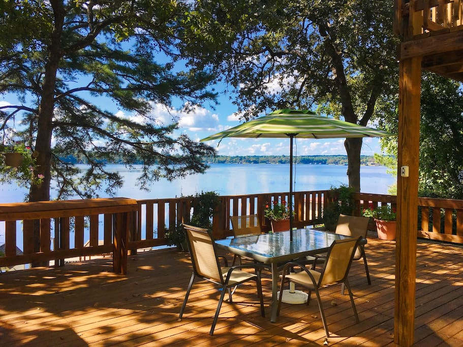The shaded, upper main deck with cabana has a great view of the lake.