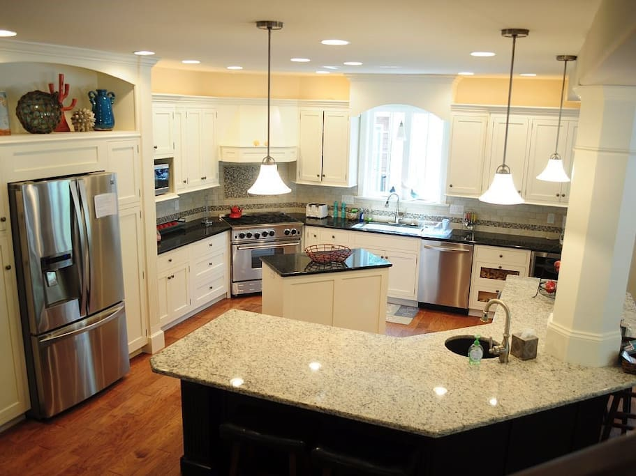 Fully stocked kitchen with 2 dishwashers, gas stove/oven, large fridge with ice and filtered water, beverage fridge.
