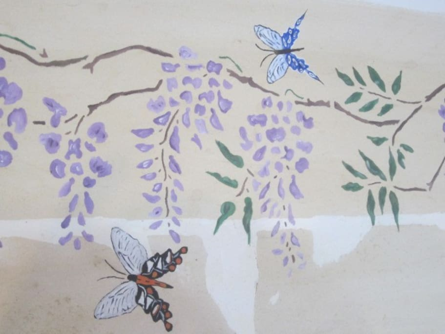 Hand painted butterflies and wisteria in guest bedroom