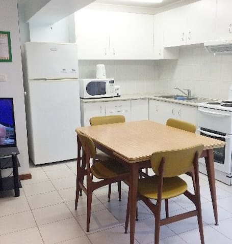 Full kitchen including full size fridge, oven/stove and microwave