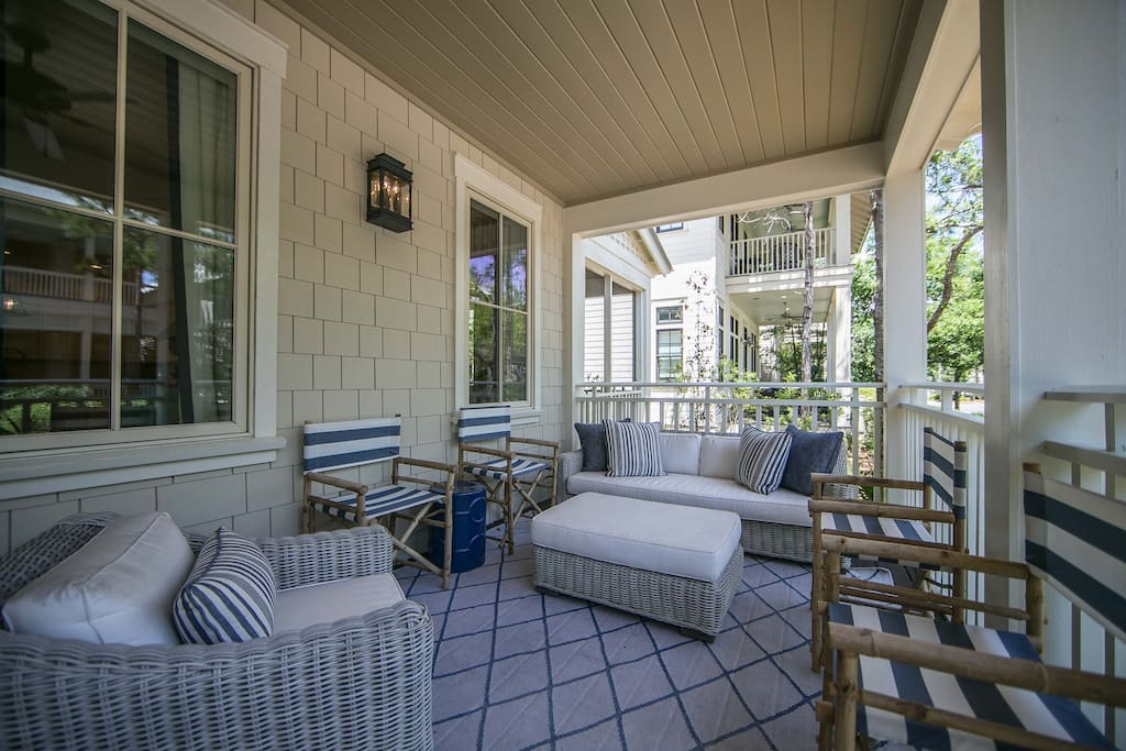 The front porch has lots of seating for your family