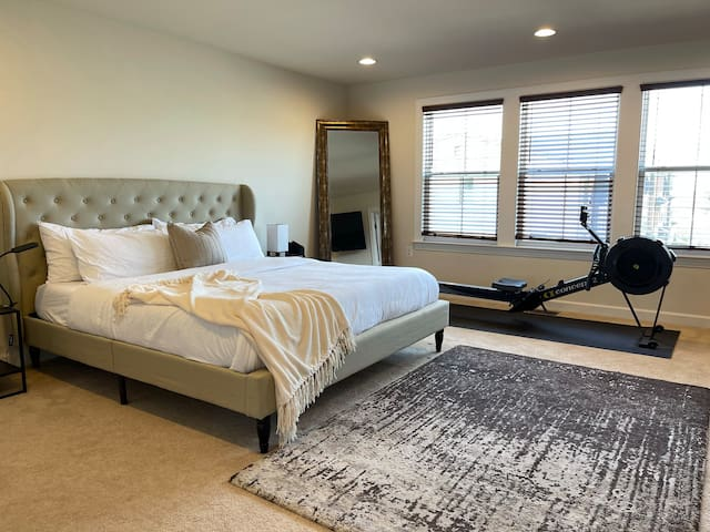 The master bedroom features a king-size Tuft and Needle memory foam bed for ultimate comfort.