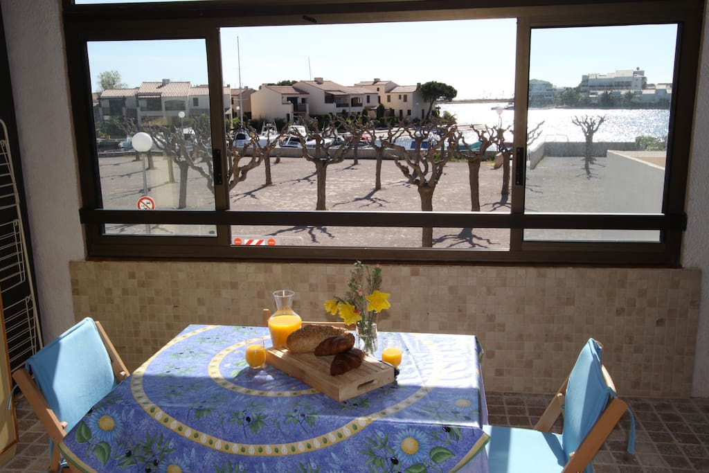 Sunny Loggia overlooking boules court and marina.