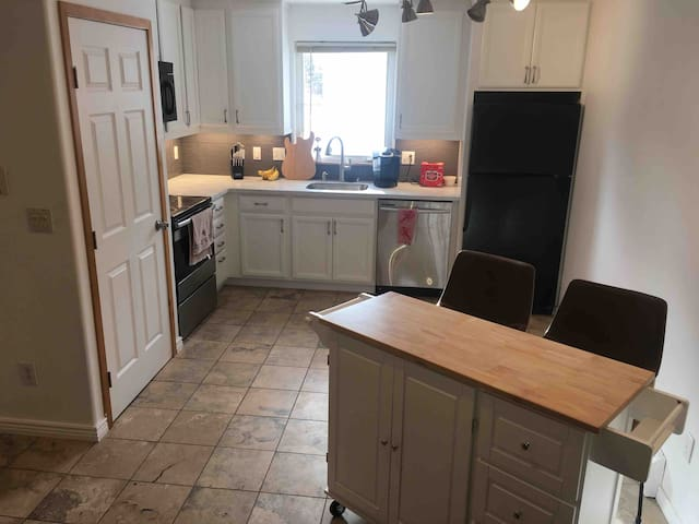 Spacious kitchen. Extra seating with new kitchen island and comfy bucket barstools.