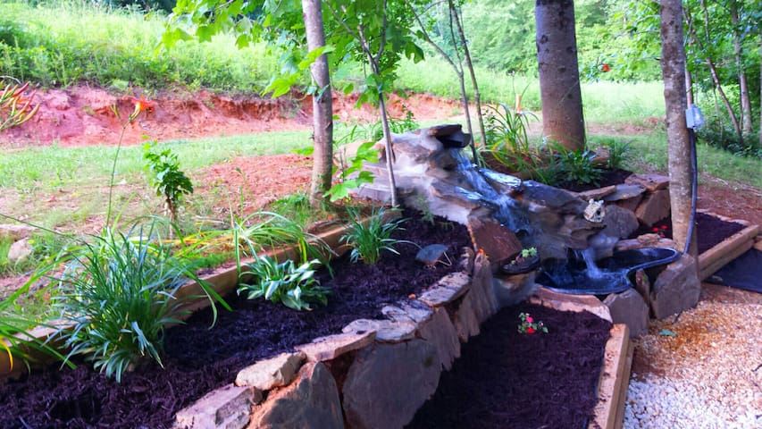 waterfall water feature and flower beds