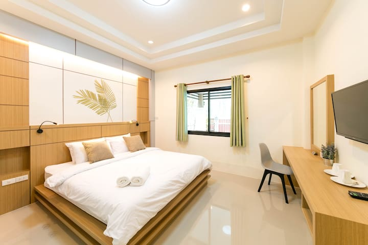 Master bedroom at front of the home with king size : bed size (WxL) : 6.0x6.5 fts. or 183x198 cm. or 72x78 in. with private bahtroom.