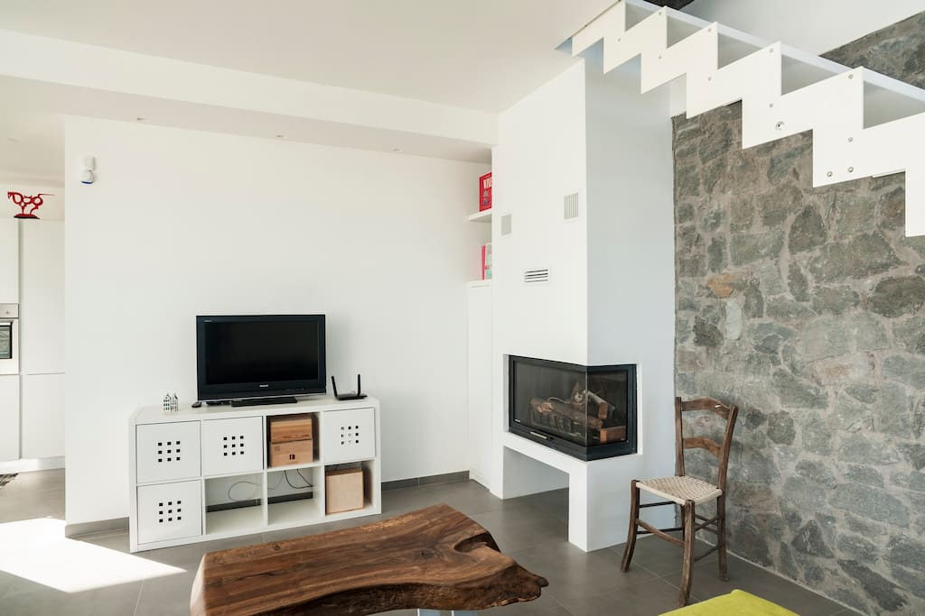 Tv next to the Fireplace