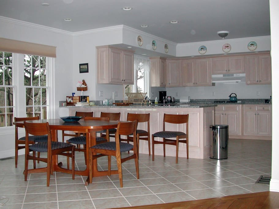 Well-stocked gourmet kitchen and dining area with expandable table