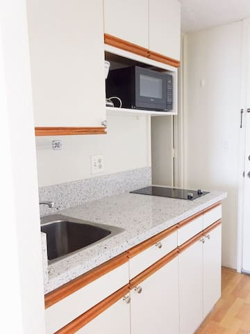 Microwave, coffee maker and basic cookware, dishes etc are in the unit.
