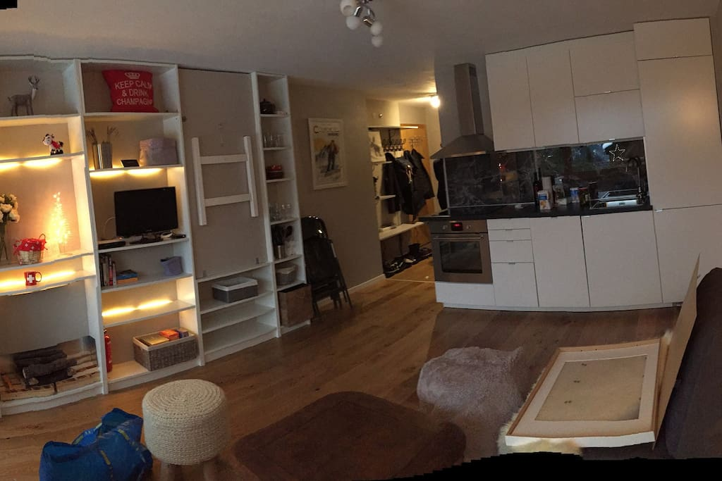 Open modern kitchen close to dining and seating area!