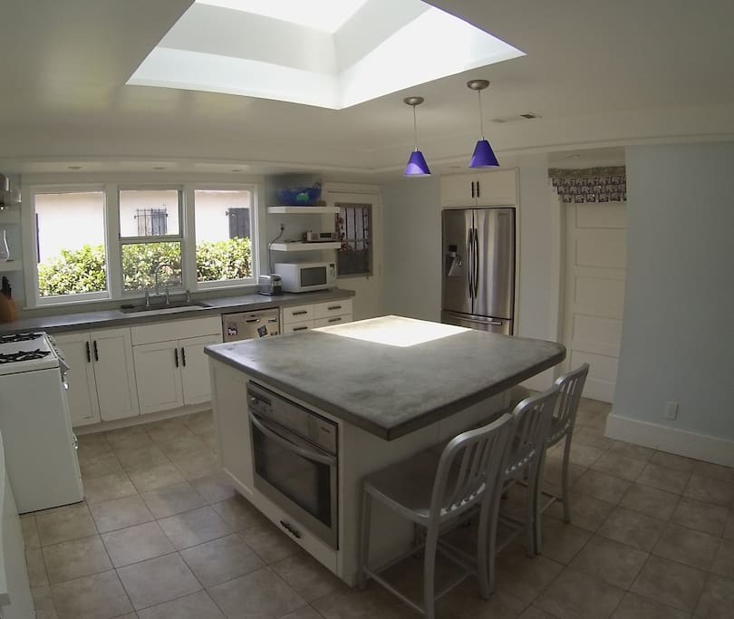 Remodeled kitchen with large island, skylight, and O'keefe Merritt gas stove--a cook's delight.