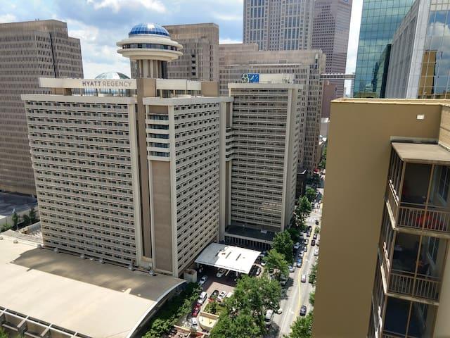 View of downtown from roof of building.  Peachtree Street and Hyatt Regency below.