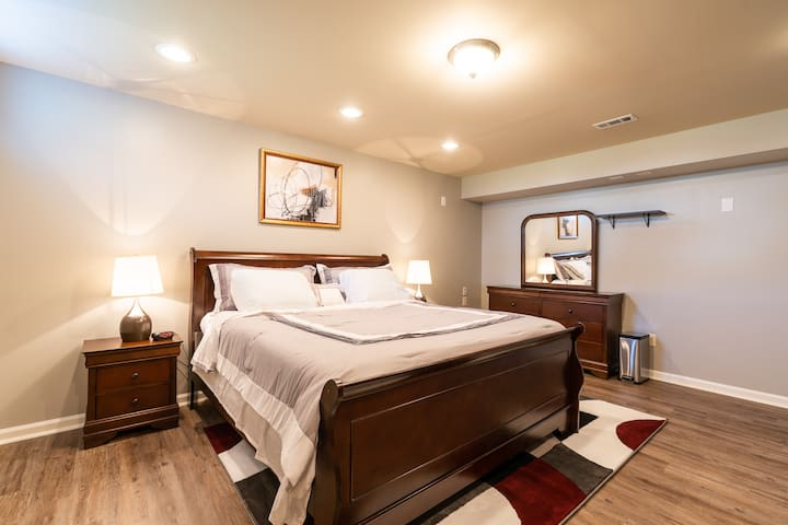 The first bedroom offers high ceiling, a brand new 8-Drawer Double Dresser with Mirror, a 2-Drawer Nightstand in Brown Cherry and a very comfortable King size bed with bedside table touch lamps and a 83.7'' H x 60.8'' W x 18.2'' Closet System.