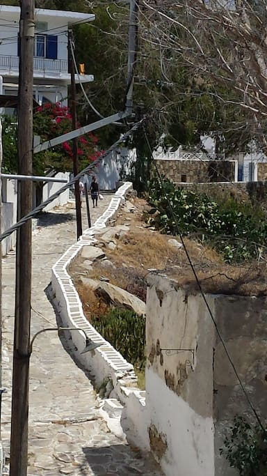 Balcony view. Traditional cycladitic step road. Ten minutes walking lead to main village. Connects Port with Chora (main village).