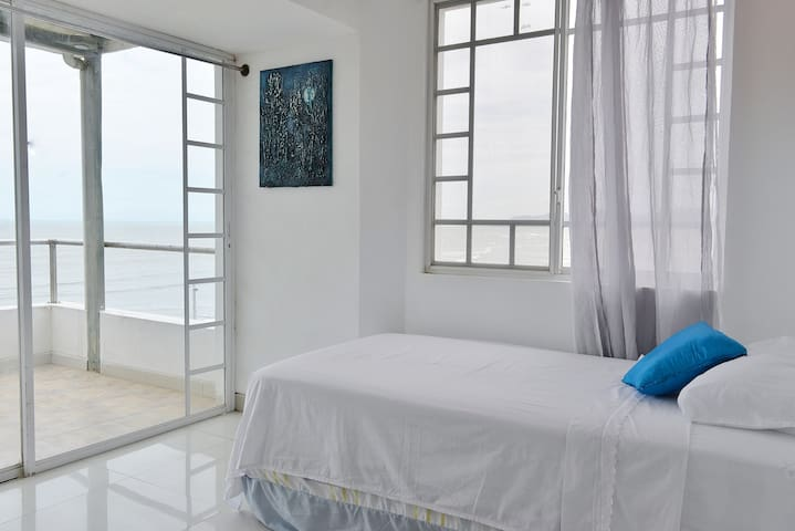The second room offers a twin-size bed, ample closet space, and has direct access to the balcony overlooking the ocean.