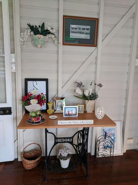 Welcome to our Queenslander. The first thing you see when you open the front door is my Nana's repurposed sewing machine and an eclectic mix of the old and the new.