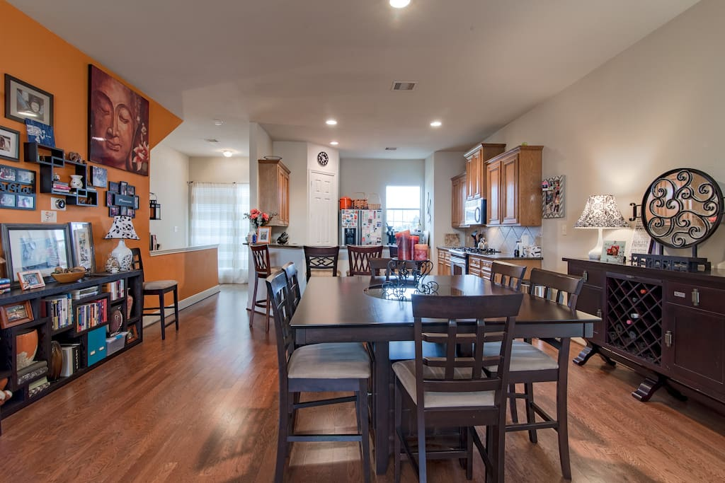 """2nd Floor   The orange """"Zen Wall"""" adds a pop of color and culture to the open floor plan."""