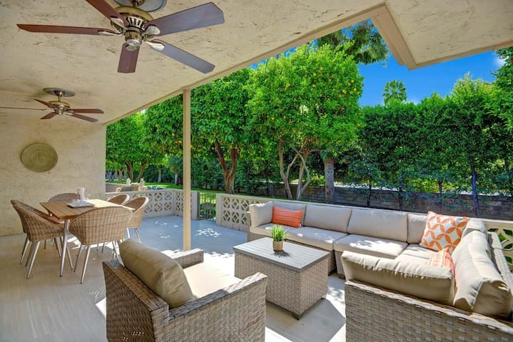 OVER OUTDOOR LIVING ROOM - Oranj Palm Vacation Homes