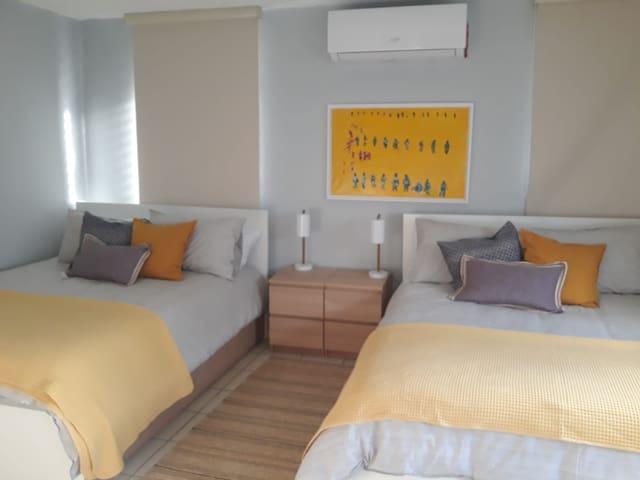 Master bedroom with 2 queen beds. A/C