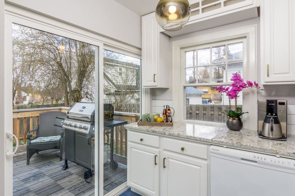 Kitchen opens to back deck w/ Gas BBQ and seating