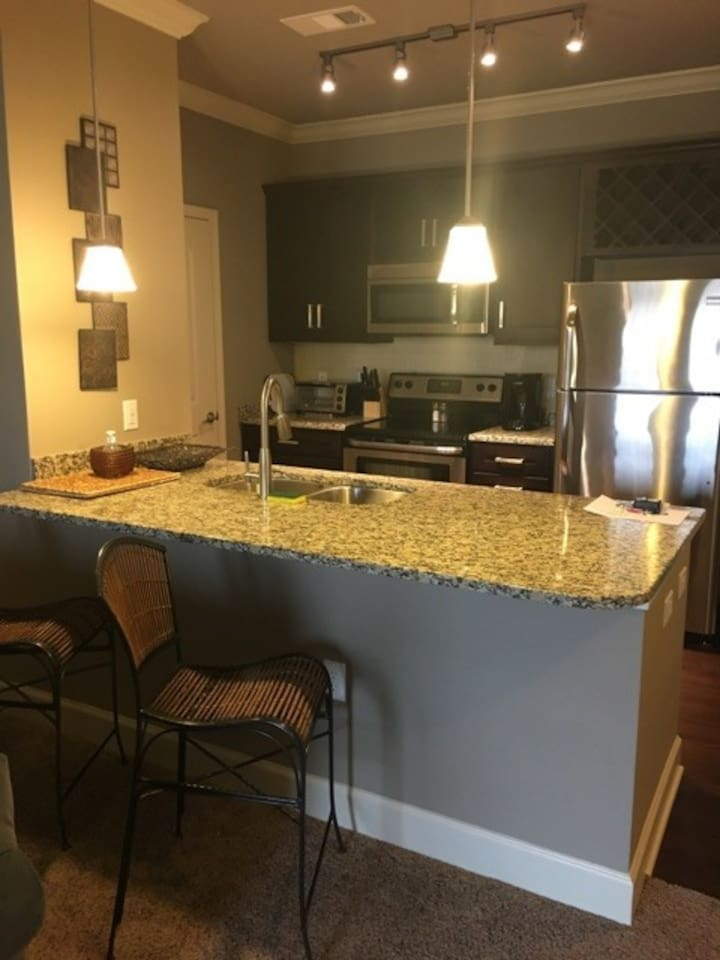 Kitchen with granite counter and stainless steel appliances