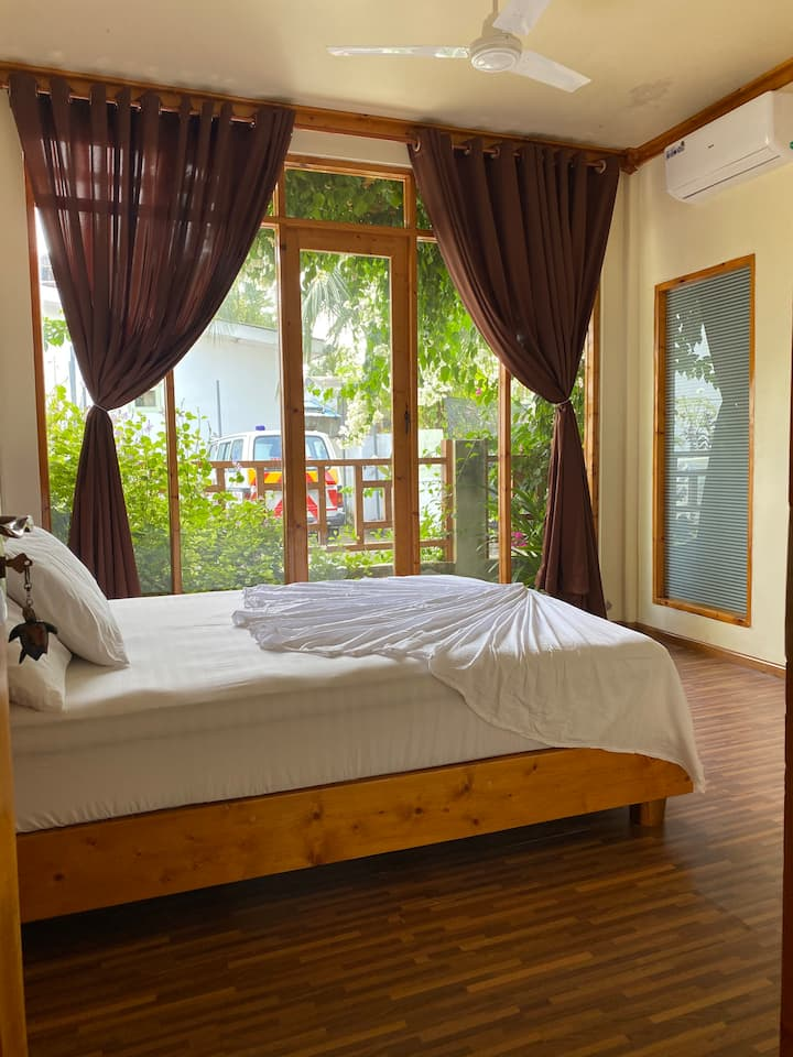 Velaa Guesthouse Queen Room ~ Private Garden Patio