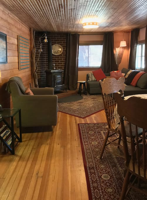 living / dining room with woodstove