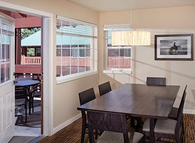 Dining Table and Exit To Private Balcony or Back Patio With Gas BBQ & Patio Set